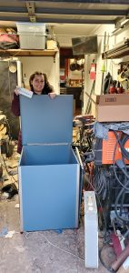 Susan posing with the smart lock box while they build it in Patrick's garage.